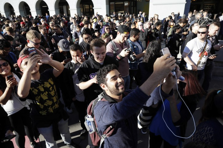 """FILE - In the Wednesday, July 20, 2016, file photo, """"Pokemon Go"""" players begin a group walk along the Embarcadero in San Francisco. """"Pokemon Go"""" was an instant hit when it debuted in July, as millions of people discovered augmented reality and joined stampedes from Central Park to Sydney capturing Pokemon via their phones. But as the hype subsides, what'™s next for the game? (AP Photo/Marcio Jose Sanchez, File)"""