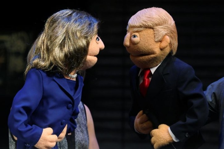 Puppets in the likeness of Democratic presidential nominee Hillary Clinton (L) and Republican presidential nominee Donald Trump (R) face-off as they pose for a photo after a mock Avenue Q sponsored debate in the Manhattan borough of New York, U.S., September 26, 2016. REUTERS/Carlo Allegri -