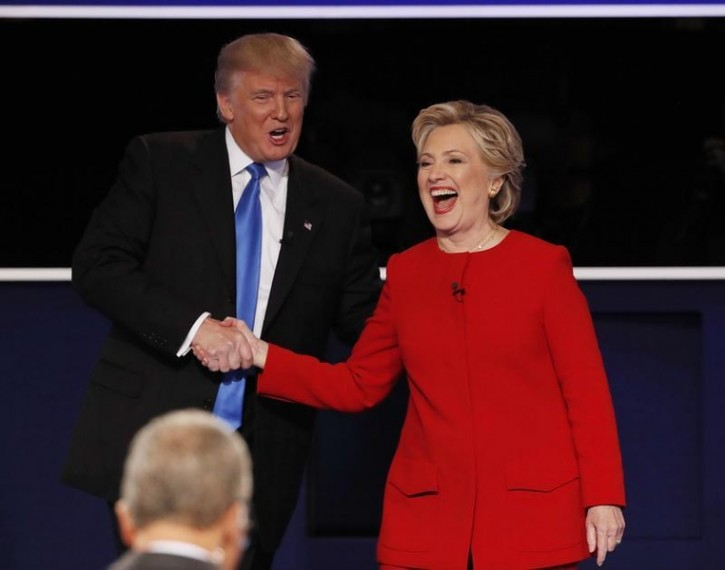 Republican U.S. presidential nominee Donald Trump shakes hands with Democratic U.S. presidential nominee Hillary Clinton at the conclusion of their first presidential debate at Hofstra University in Hempstead, New York, U.S., September 26, 2016. REUTERS/Mike Segar