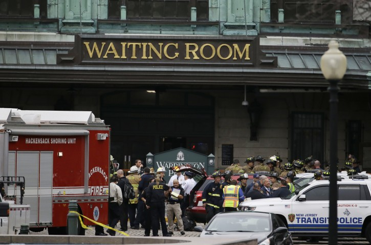 Emergency officials stand outside of the Hoboken Terminal following a train crash, Thursday, Sept. 29, 2016, in Hoboken, N.J. A commuter train has crashed into the rail station during the morning rush hour, causing serious damage. (AP Photo/Julio Cortez)