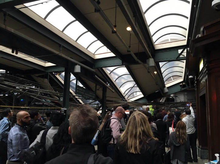 This photo provided by Ian Samuel shows the scene of a train crash in Hoboken, N.J., on Thursday, Sept. 29, 2016.  A commuter train barreled into the New Jersey rail station during the Thursday morning rush hour, causing serious damage. The train came to a halt in a covered area between the station's indoor waiting area and the platform. A metal structure covering the area collapsed.  ( Ian Samuel via AP)