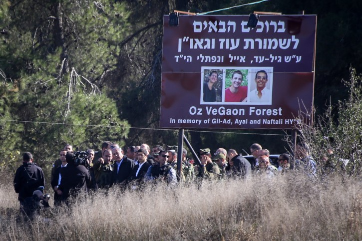FILE - Israeli Prime Minister Benjamin Netanyahu is surrounded by security as he visits at the Givat Oz Vegaon which was established in response to the kidnap and murder of the three Jewish teens, Gilad Sha'ar, Naftali Frenkel, and Eyal Ifrach, and was named after them, near the Gush Etzion junction, an area which has been hit by several terror attacks in the past weeks. November 23, 2015. Photo by Gershon ELinson/FLASH90