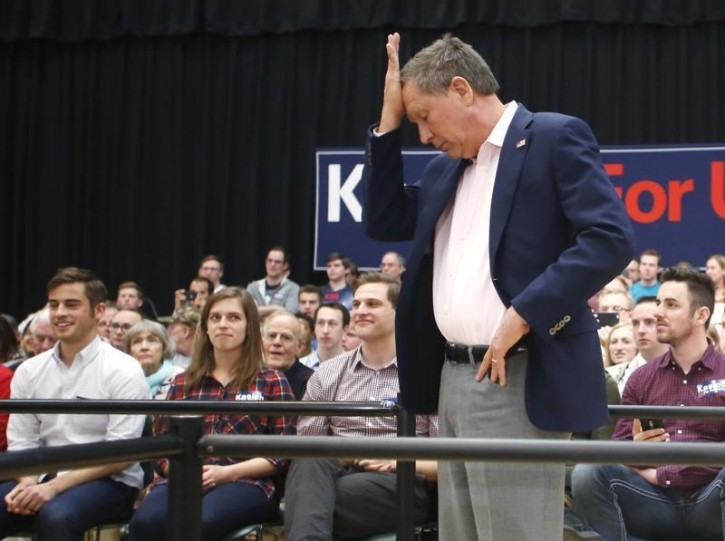 FILE - U.S. Republican presidential candidate John Kasich puts his hand to his head at a campaign town hall event in Orem, Utah March 18, 2016.   Reuters