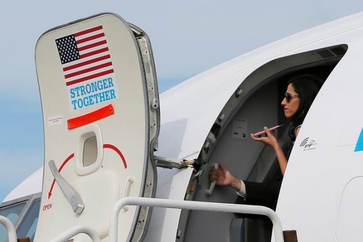 Huma Abedin, aide to U.S. Democratic presidential candidate Hillary Clinton, stands in the doorway of the campaign plane in White Plains, New York, U.S., September 27, 2016.  REUTERS/Brian Snyder
