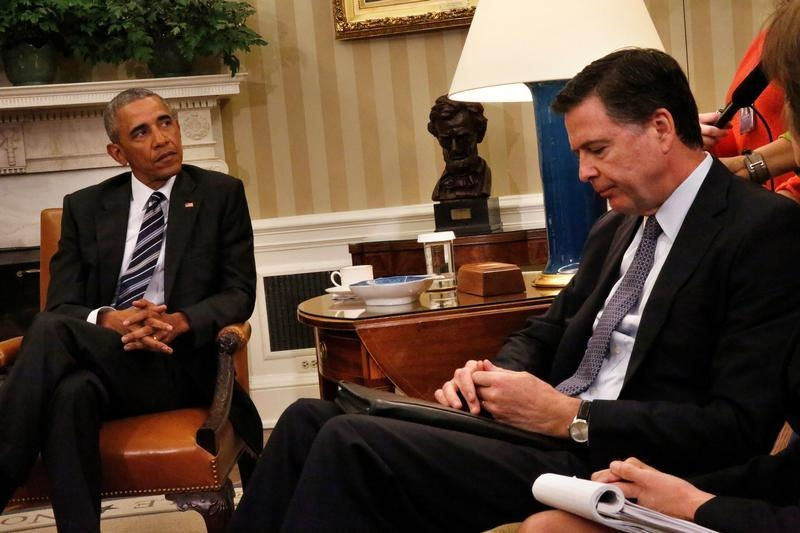 file us president barack obama attends a meeting with fbi director james comey r fileobama oval officejpg