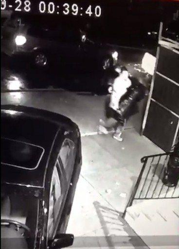 Security surveillance footage shows a man double-parked and placing the four bags containing the Sifrei Torah outside the Shul.