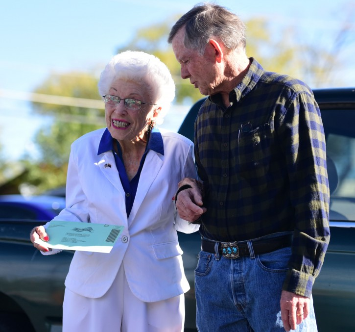 """Jerry Emmett, who was born before women won the right to vote in the U.S., leaves the Yavapai County Administration Building with her son Jim, after casting her early ballot in the 2016 presidential election Tuesday, Nov. 1, 2016, in Prescott, Ariz. Emmett, who is 102 years old, voted for Franklin Delano Roosevelt in her first Presidential election. """"I am getting to vote for Hillary Clinton for president which has been my dream since Bill Clinton was President."""" Emmett said. (Les Stukenberg/The Daily Courier via AP)"""