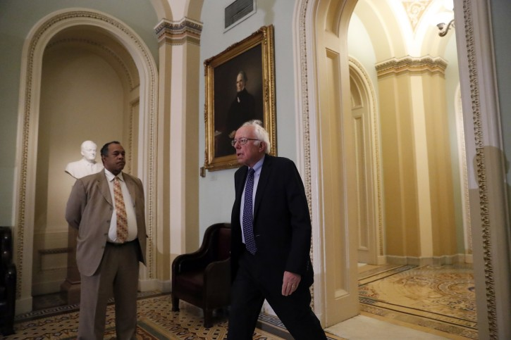Sen. Bernie Sanders, I-Vt., arrives for a caucus organizing meeting to elect their leadership for the 115th Congress, Wednesday, Nov. 16, 2016, on Capitol Hill in Washington. (AP Photo/Alex Brandon)