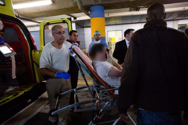 FILE - Paramedics wheel Eli Borochov  into the emergency room of the Shaare Zedek Medical Center on November 6, 2015. Flash90