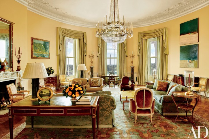 The image provided by Architectural Digest shows the Yellow Oval Room in the White House in Washington in a cover story about . Designer Michael S. Smith specified a Donald Kaufman paint for the Yellow Oval Room. Artworks by Paul Cézanne and Daniel Garber flank the mantel. (Michael Mundy/Architectural Digest via AP)