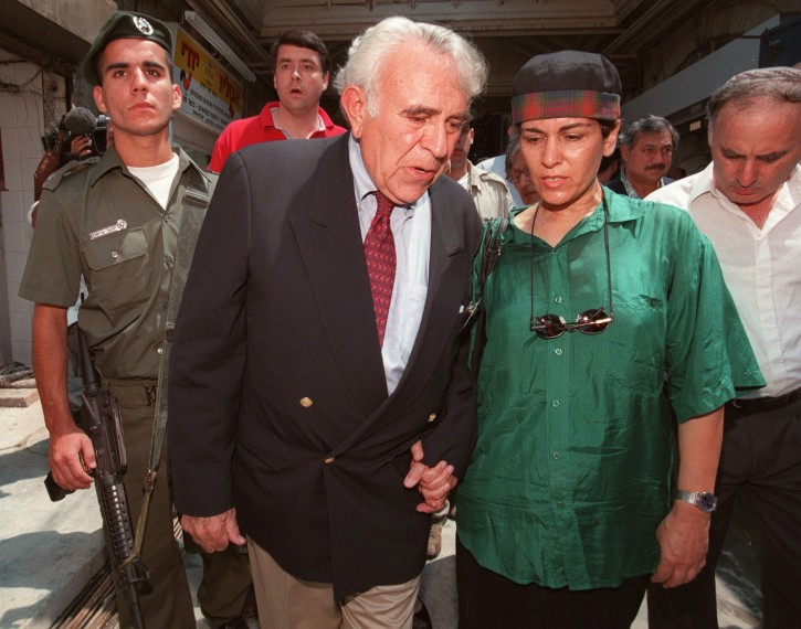 FILE - U.S Congressman Ben Gilman, Chairman House of International Affairs Committee walks through the Mahane Yehuda market in Jerusalem hand in hand with Tsafi Adorian who's husband was killed in the market bombing, Thursday, Aug. 21 1997. AP