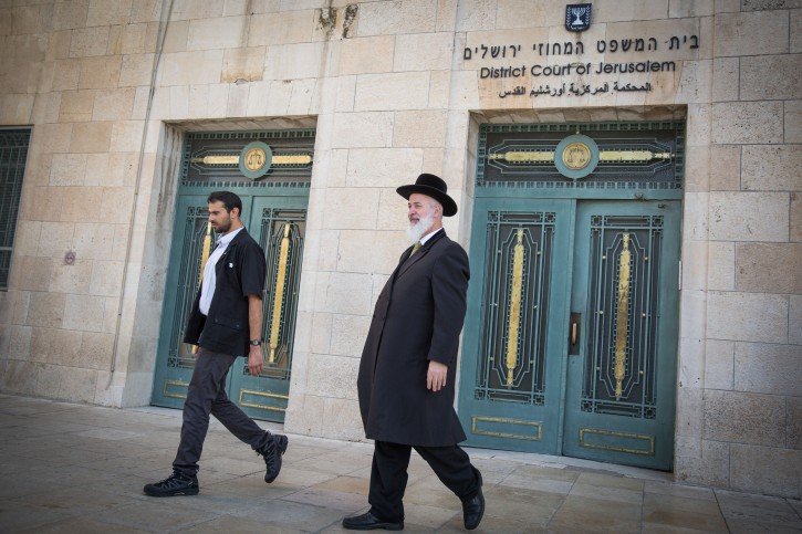 FILE - Former Chief Rabbi of Israel, Yona Metzger seen at the Jerusalem District Court at the opening of his trial, where he is suspected of taking bribed, fraud, and involvement in criminal activities, on March 10, 2016. Photo by Hadas Parush/Flash90