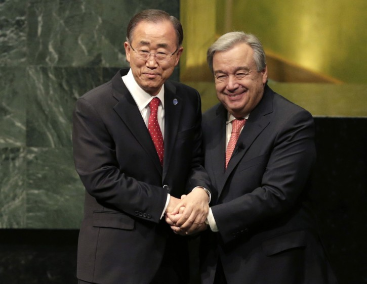 FILE- In this Dec. 12, 2016 file photo, current United Nations Secretary-General Ban Ki-moon, left, clasps hands with U.N. Secretary-General designate Antonio Guterres after Guterres was sworn in at U.N. headquarters. Guterres begins his term on Sunday, Jan. 1, 2017. (AP Photo/Seth Wenig, File)