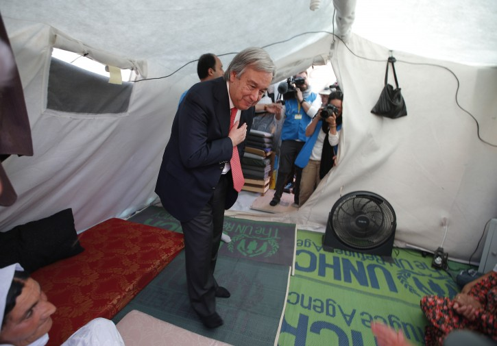 FILE- In this June 20, 2015 file photo, United Nations High Commissioner for Refugees Antonio Guterres enters a family tent during a visit to the Midyat refugee camp in Mardin, southeastern Turkey, near the Syrian border. Guterres succeeds Ban Ki-moon, who lead the UN for ten years on Jan. 1, 2017. (AP Photo/Emrah Gurel, File)
