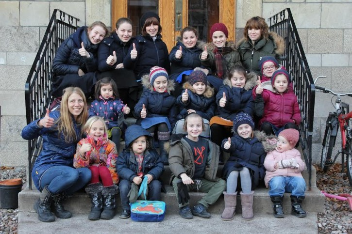 Sarah Dorner and her daughter Zoe, on lower left, with their Chasidic neighbors in Outremont on Dec. 4, 2016 (courtesy)