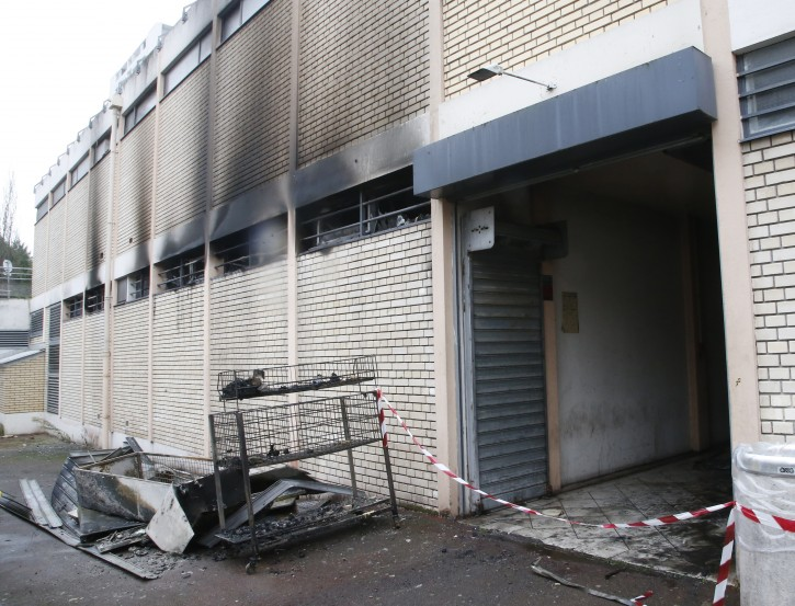 The back of a kosher market is pictured after a fire broke out in Creteil, south of Paris, Tuesday, Jan.9, 2018. French officials say the fire broke out at the kosher market south of Paris that was vandalized with anti-Semitic graffiti last week. (AP Photo/Michel Euler)