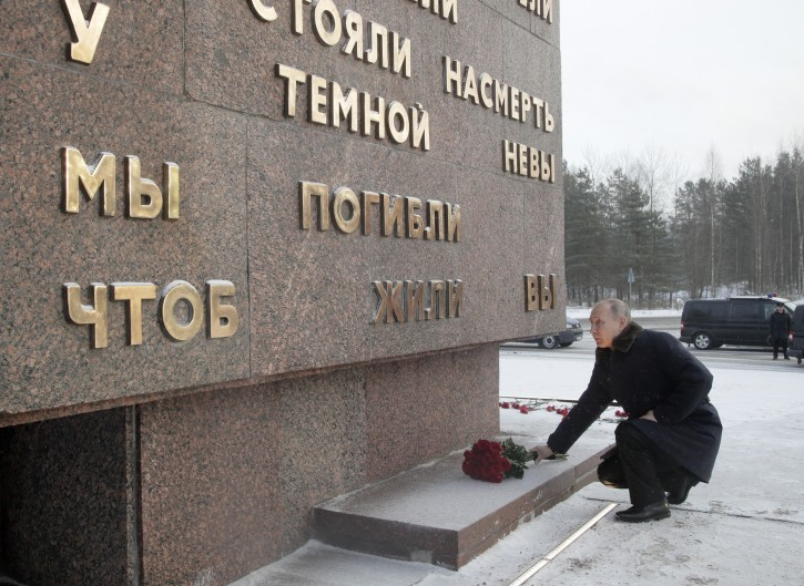Russian President Vladimir Putin puts flowers on a monument at Nevsky Pyatachok near Kirovsk, to mark the 75th anniversary of the battle that broke the Siege of Leningrad, in St, Petersburg, Russia, Thursday, Jan. 18, 2018. (AP Photo/Dmitri Lovetsky, pool)