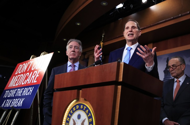 In this Oct. 4, 2017 photo, Rep. Ron Wyden, D-Ore. with Rep. Richard Neal, D-Mass., left, and Senate Minority Leader Chuck Schumer of New York, right, speak during a news conference on Capitol Hill in Washington, Wednesday, Oct. 4, 2017, urging Republicans to abandon cuts to Medicare and Medicaid.   (AP Photo/Manuel Balce Ceneta)
