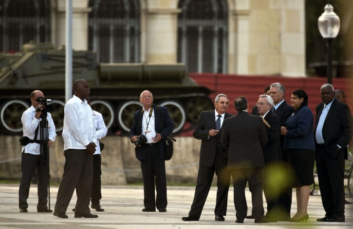 Cuba's President Raul Castro, center, talks with several leaders of the Cuban government after the ceremony of unveiled a replica of a New York statue of Cuba's independence hero Jose Marti  in Havana, Cuba, Sunday, Jan. 28, 2018. The monument was unveiled on the 165th anniversary of the birth of the Cuban independence hero in a ceremony attended by a delegation of U.S. organizers of the event and top officials of the Cuban Government. (AP Photo/Ramon Espinosa)