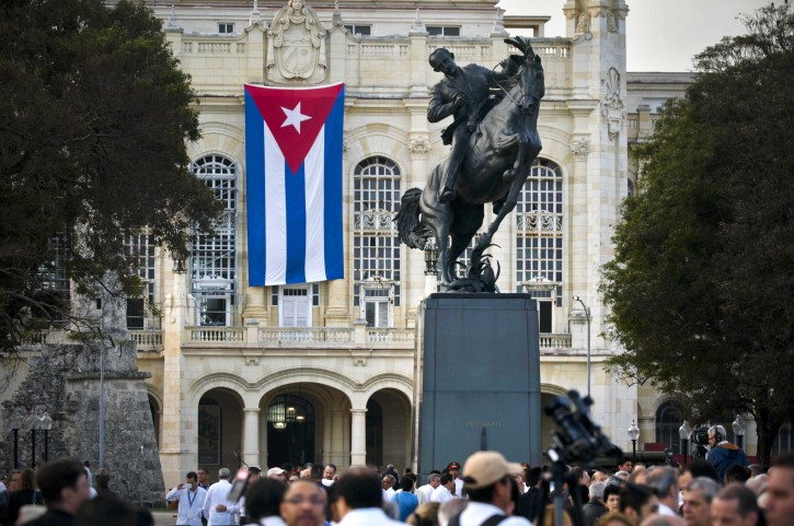 People attend a ceremony of unveiled a replica of a New York statue of Cuba's independence hero Jose Marti  in Havana, Cuba, Sunday, Jan. 28, 2018. The monument was unveiled on the 165th anniversary of the birth of the Cuban independence hero in a ceremony attended by a delegation of U.S. organizers of the event and top officials of the Cuban Government, including President Raul Castro. (AP Photo/Ramon Espinosa)
