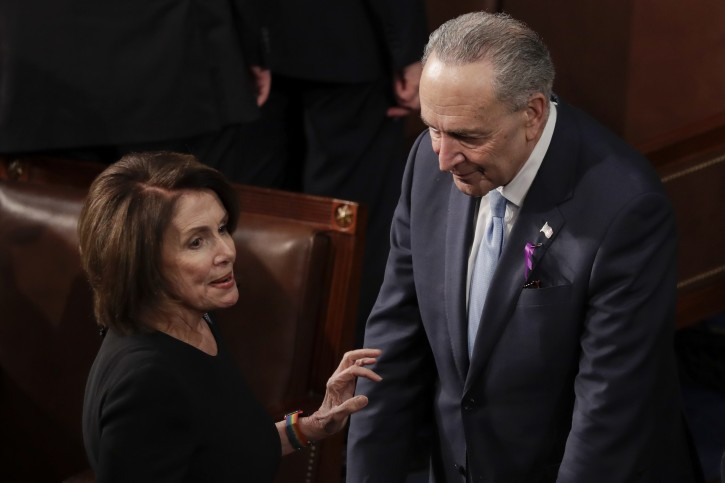 House Minority Leader Nancy Pelosi of California talks with Senate Minority Chuck Schumer of New York before the State of the Union address to a joint session of Congress on Capitol Hill in Washington, Tuesday, Jan. 30, 2018. (AP Photo/J. Scott Applewhite)