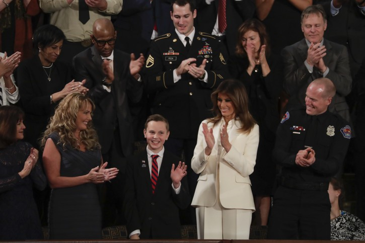 Preston Sharp waves from the first lady's box during the State of the Union address to a joint session of Congress on Capitol Hill in Washington, Tuesday, Jan. 30, 2018. (AP Photo/J. Scott Applewhite)