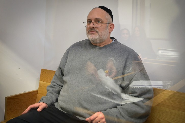 Yehoshua Elitzur who was convicted of killing Palestinian taxi driver Sael A-Shatiya in 2004, is seen at the Tel Aviv District Court after he was extradited from Brazil, January 18, 2018. Photo by Flash90