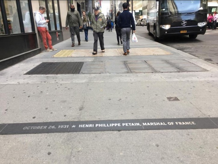 """The granite markers commemorating Pétain and Laval are located on Morris and Broadway in the Wall Street area's """"Canyon of Heroes."""" Both men helped the Nazis deport and murder nearly 100,000 Jews, as well as Gypsies and homosexuals. After the war, Laval was executed for his war crimes. Pétain was convicted of treason in 1945 and sentenced to death by firing squad but France's President Charles de Gaulle commuted the sentence to life imprisonment."""