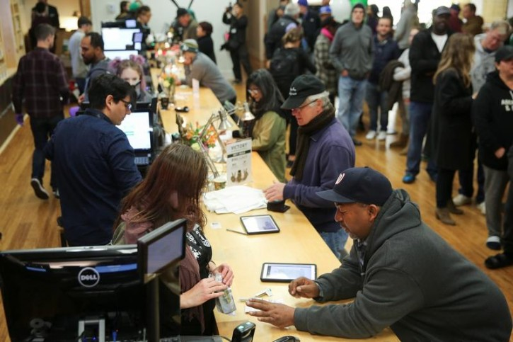 Customers purchase marijuana at Harborside, one of California's largest and oldest dispensary dispensaries of medical marijuana, on the first day of legalized recreational marijuana sales in Oakland, California, U.S., January 1, 2018. REUTERS/Elijah Nouvelage