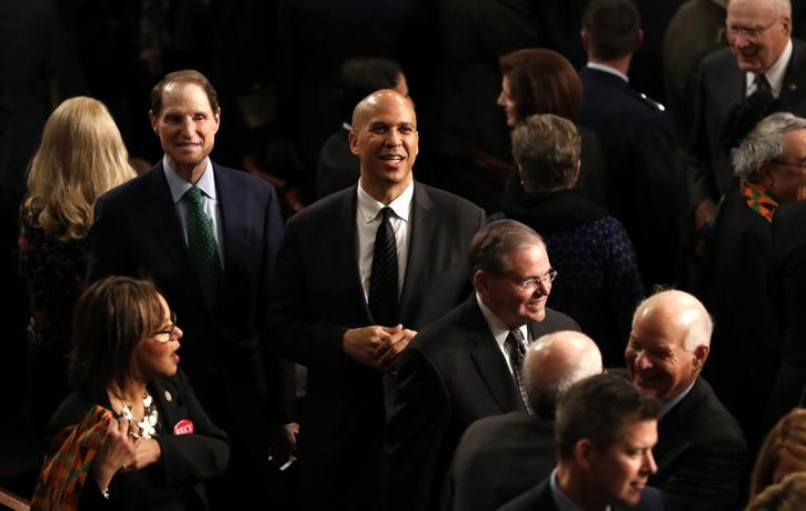 Senators Ron Wyden, Cory Booker and Robert Menendez (L to R) arrive on the floor of the House for U.S. President Donald Trump's State of the Union address to a joint session of the U.S. Congress on Capitol Hill in Washington, U.S. January 30, 2018. REUTERS/Leah Millis