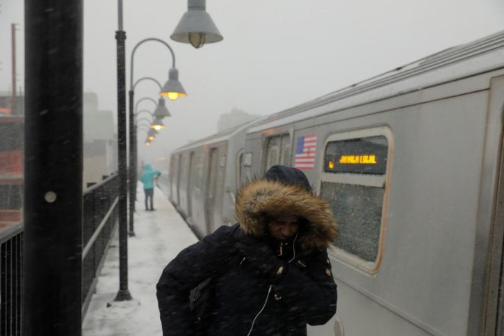 A commuter walks on a subway platform in Brooklyn during a snowstorm in New York City, New York, U.S., January 4, 2018. REUTERS/Lucas Jackson