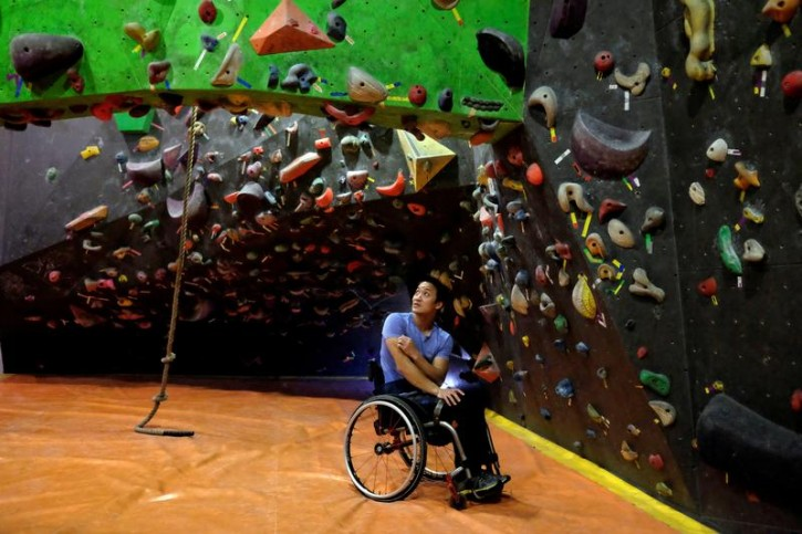 Wheelchair-bound Lai Chi-wai, the first Chinese to be nominated for Laureus World Sports, poses at a rock climbing gym in Hong Kong, China January 5, 2018. Picture taken January 5, 2018. REUTERS/Bobby Yip -