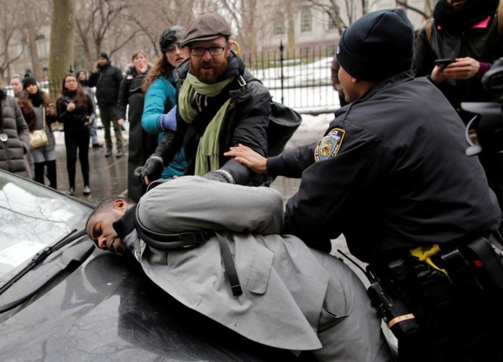 New York City Council member Jumaane D. Williams is detained by police during a demonstration by activists against deportation outside the Jacob Javits Federal Building in Manhattan in New York City, U.S., January 11, 2018. REUTERS/Eduardo Munoz