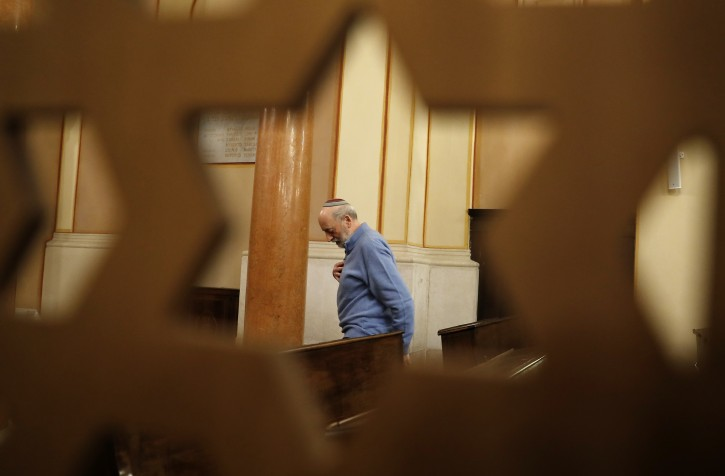 In this photo taken on Friday, Feb. 2, 2018, President of the Jewish Community Bruno Carmi stands inside a Synagogue in Verona, Italy. Racist and anti-Semitic expressions have been growing more bold, widespread and violent in Italy. Anti-migrant rhetoric is playing an unprecedented role in shaping the campaign for the March 4 national elections, and many say that is worsening tensions and even encouraging violence. (AP Photo/Antonio Calanni)