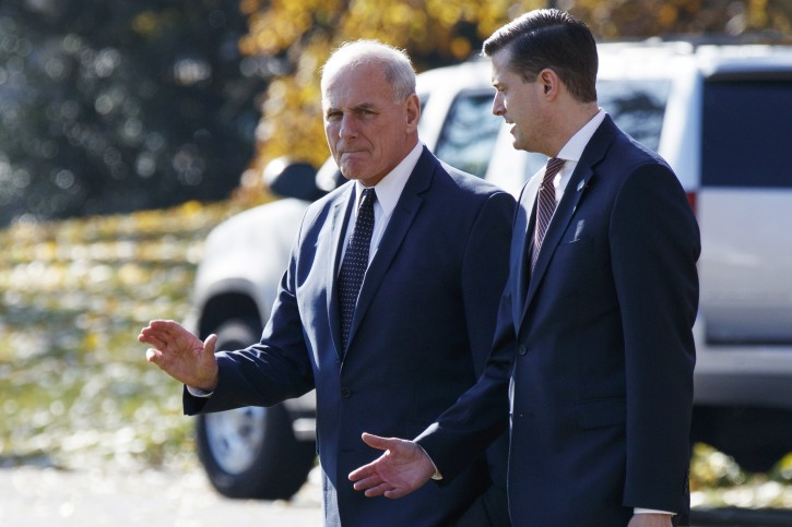 White House Chief of Staff John Kelly, left, walks with White House staff secretary Rob Porter to board Marine One on the South Lawn of the White House, Wednesday, Nov. 29, 2017, in Washington. (AP Photo/Evan Vucci)