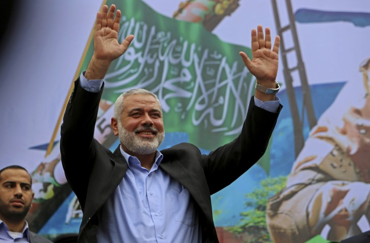 File - In this Friday, Dec. 12, 2014 file photo, Palestinian top Hamas leader Ismail Haniyeh greets supporters during a rally to commemorate the 27th anniversary of the Hamas militant group, at the main road in Jebaliya in the northern Gaza Strip.(AP Photo/Adel Hana, File)