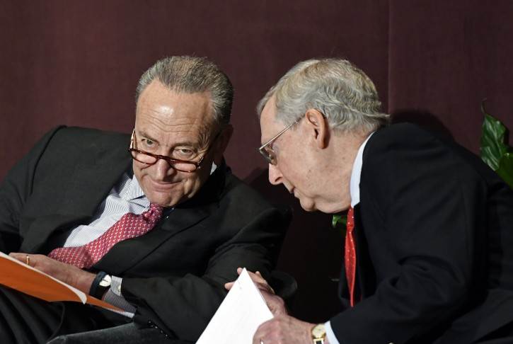 Senate Minority Leader Charles Schumer, D-N.Y., left, talks with Senate Majority Leader Mitch McConnell, R-Ky., before his speech at the McConnell Center's Distinguished Speaker Series Monday, Feb. 12, 2018, in Louisville, Ky. (AP Photo/Timothy D. Easley)
