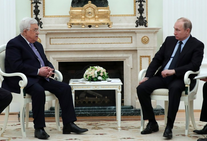 Russian President Vladimir Putin, right, listens to Palestinian President Mahmoud Abbas, during their meeting in the Kremlin in Moscow, Russia, Monday, Feb. 12, 2018. Putin says at a meeting with the Palestinian leader that he has just had a phone call with U.S. President Donald Trump. (Mikhail Klimentyev, Sputnik, Kremlin Pool Photo via AP)