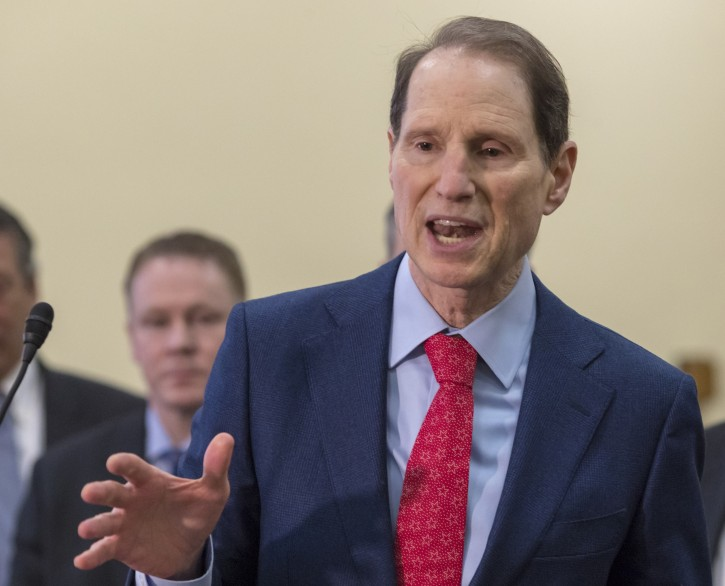 Sen. Ron Wyden, D-Ore., a member of the Senate Intelligence Committee, center, joins a bipartisan group of House and Senate lawmakers at a news conference where they were united in their insistence on reforms to the FISA Amendments Reauthorization Act of 2017 to protect Americans' rights, at the Capitol in Washington, Wednesday, Jan. 10, 2018. (AP Photo/J. Scott Applewhite)