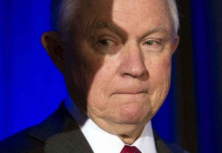 Attorney General Jeff Sessions waits onstage to address the National Sheriffs' Association Winter Conference on law enforcement efforts to combat the opioid crisis and violent crime, in Washington, Monday, Feb. 12, 2018. (AP Photo/Cliff Owen)