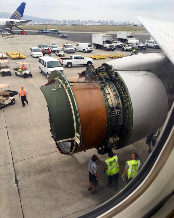 This photo provided by passenger Haley Ebert shows damage to an engine on what the FAA says is a Boeing 777 after parts came off the jetliner during its flight from San Francisco to Honolulu Tuesday, Feb. 13, 2018. The plane landed safely as emergency responders waited nearby. United spokeswoman Natalie Noonan says Flight 1175 made an emergency landing due to a mechanical issue. (Haley Ebert via AP)