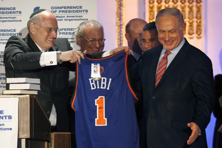 FILE - Israel's Prime Minister Benjamin Netanyahu (R) is presented with a New York Knicks basketball jersey by Malcolm Hoenlein, Vice Chairman of the Conference of Presidents of Major American Jewish Organizations, after Netanyahu's address to the group in New York July 7, 2010. REUTERS/Mike Segar