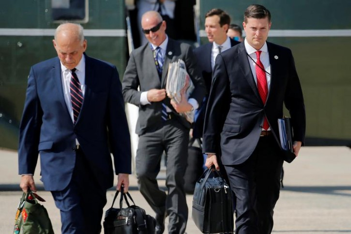 FILE - White House Staff Secretary Rob Porter (R) and White House Chief of Staff John Kelly (L) walk to board Air Force One with U.S. President Donald Trump en route to New Jersey from Joint Base Andrews, Maryland, U.S. August 4, 2017. Picture taken August 4, 2017. REUTERS/Jonathan Ernst