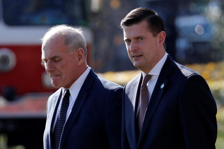 White House Chief of Staff John Kelly walks with White House Staff Secretary Rob Porter to depart with U.S. President Donald Trump aboard the Marine One helicopter from the White House in Washington, U.S. November 29, 2017. Picture taken November 29, 2017. REUTERS/Jonathan Ernst