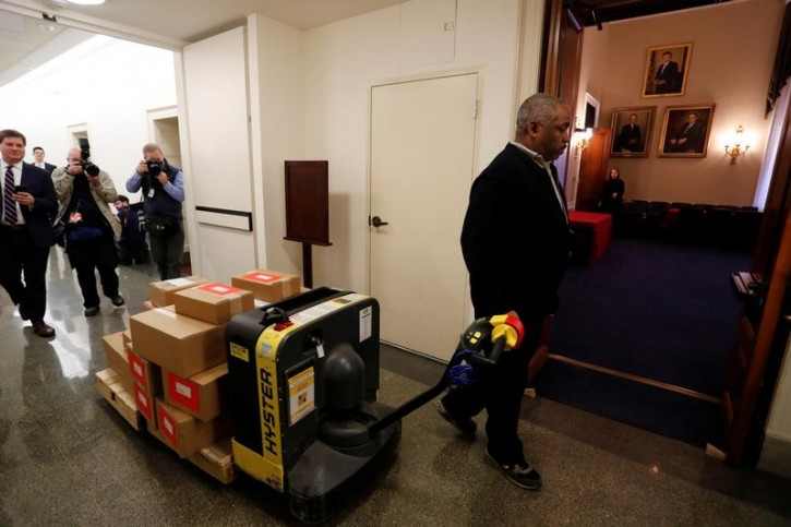 Copies of the President Trump's FY 2019 budget proposal are delivered to the U.S. House Budget Committee offices on Capitol Hill in Washington, U.S. February 12, 2018.  REUTERS/Jonathan Ernst