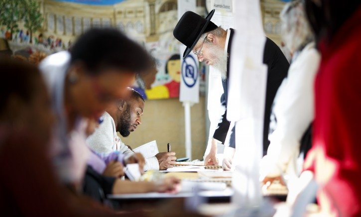 FILE -  Polling site workers help voters at a polling location for the 2016 US presidential election in a senior center in Brooklyn, New York, USA, 08 November 2016. EPA