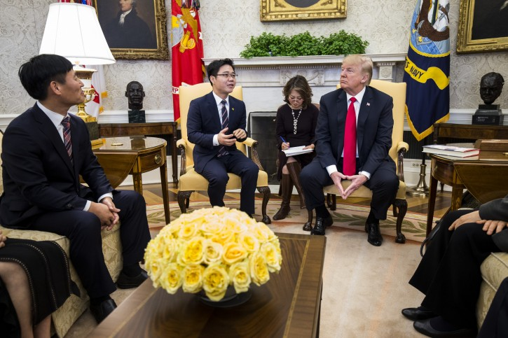 North Korean defector Ji Seong-ho (2-L) speaks during a meeting with US President Donald J. Trump in the Oval Office of the White House in Washington, DC, USA, 02 February 2018. EPA