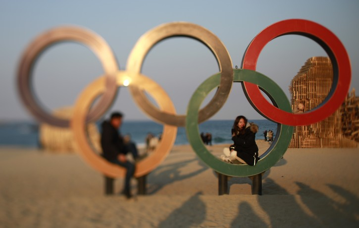 A picture taken with a tilt-shift lens of people posing for photos on the Olympic rings at Gyeongpo beach near the Olympic village in Gangneung,South Korea, 08 February 2018. The PyeongChang 2018 Winter Games Olympics will run from 09 to 25 February 2018.  EPA-EFE/HOW HWEE YOUNG