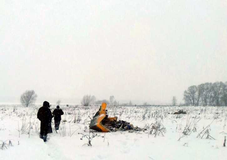 A picture made available on 12 February 2018 shows a debris of the crashed Russian Saratov Airlines Antonov AN-148 passenger plane lies in the snow near the Stepanovskoy village near Argunovo, Ramensky district, Moscow region, Russia, 11 February 2018. EPA