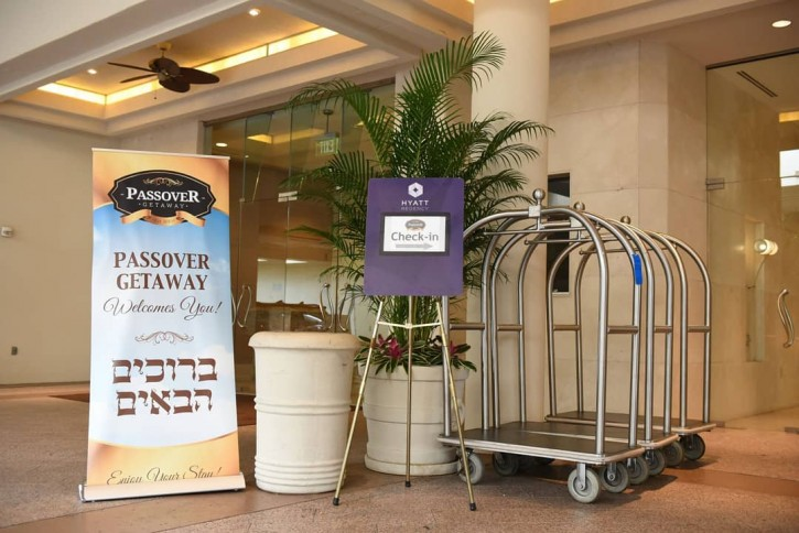 In this photo taken April, 9 2017, a welcome sign by the Passover Getaway is displayed at the entranceway of the Hyatt Regency Orlando.  (Eli Wohl/VINnews.com)